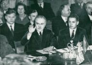 Molotov took a bitter attitude at the negotiations. In the picture he raises his hand to protest