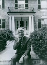 U.S. politician, John Anderson, outside his home-cum-office in Washington, DC, 1983.