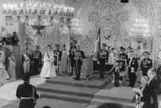 People standing in a formal ceremony.