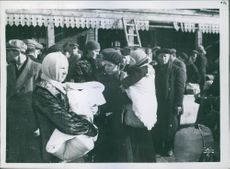 Russians in Barentsburg waiting to be taken on board. 1941.