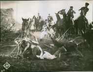 Vintage photo of war soldiers and horses that fell down on the ground during the first world war.
