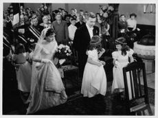 A wedding ceremony scene from a film.