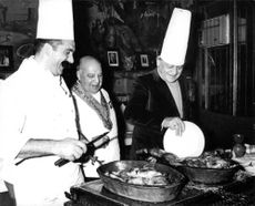 Henri Charriere with chef, cooking food.