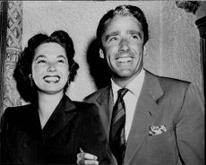 The two Hollywood actors Ruth Roman and Peter Lawford photographed together.