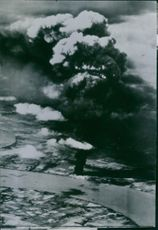 Aerial view of a huge smoke from Japanese oil tank.