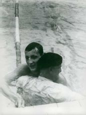 A swimmer has been helped by a man on the pool during the Olympic Games.