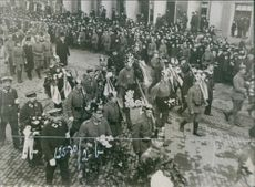 Military people marching on the street. 1916.