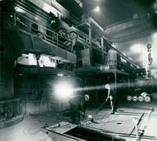 Samples on the melt are taken with a long-shovel bucket from an electro-steel furnace at Halmstad's Ironworks