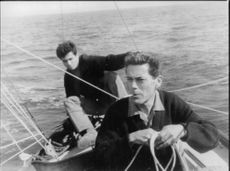 Jacques Monod on boat with a man.