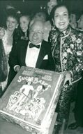 """Mickey Rooney and Ann Miller are congratulated with a cake on the opening night of """"Sugar Babies"""""""