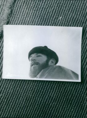 A photo frame of a man lying down.