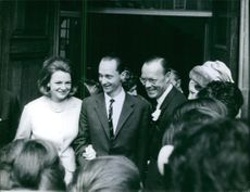 Carlos Hugo, Duke of Parma is with his wife and facing the crowd. 1964