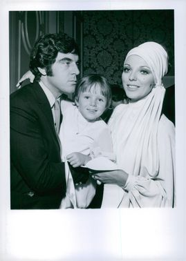 English actor Anthony Newley and Joan Collins and their daughter Tara attend the ammual MOMS' N MOPPETS Fashion Show and luncheon at the Beverly Hilton Hotel in Beverly Hills