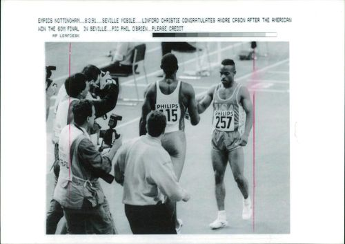 Linford Christie with Andre Cason.