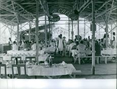 View of a restaurant, people sitting and enjoying.