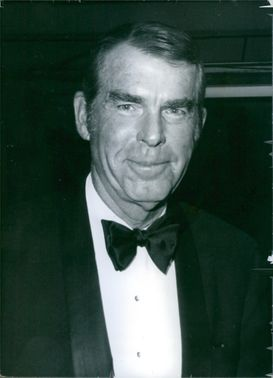 Close up of American actor Fred MacMurray, while he looking towards the camera with smiling face