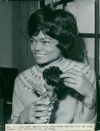 Eartha Kitt with a little doll in his hand