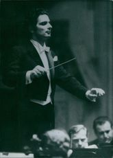 Alain Lombard instructing the orchestra.