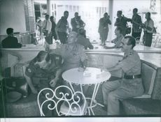Soldiers sitting together and ordering food.