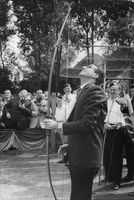 King Baudouin with a bow, looking up.