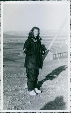 Oberleutnant Nora Petruzzi standing and looking at something.