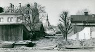 Södertälje's old shack building is torn to make room for business houses. In the background S: ta Ragnhild's church