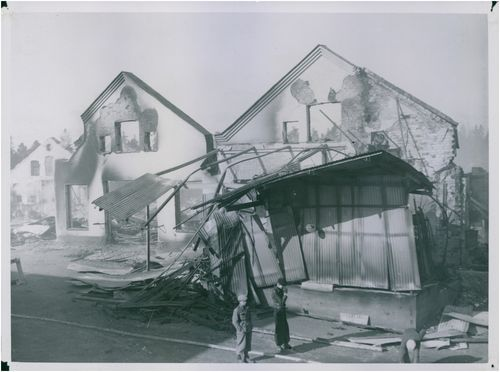 Photo of destroyed house.