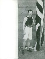 James B. Connolly holding flag during Olympic games in 1896.