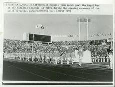 The Swedish Olympic team marches past the Royal Box at the Olympic Games