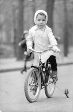 Brigitte Bardot's child riding bicycle.