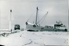 Ship docked on a frozen coast in Mariestad, Sweden.  - 1968
