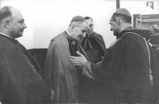 Pope Paul VI talking with a cardinal.