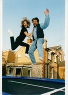 Davy Jones (The Monkees) and daughter Sarah jump on the trampoline