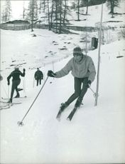 Man skiing, passing obstacles.  - Dec 1961