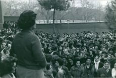 A huge group of women gathered with a woman speaking in front of them, 1963.