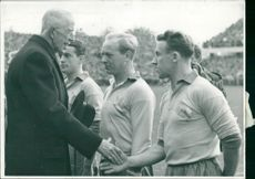 King Gustaf V greets the football players before the Sweden - Germany match