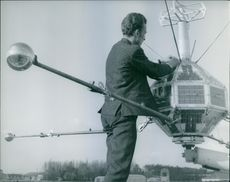 Man repairing a satellite in France.