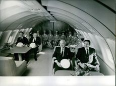 1970 Aircraft members sitting together in the airplane Boeing 747.