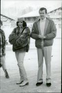 Joan Collins and Roger Moore during a vacation Gstaad