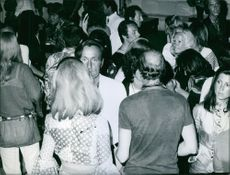 People gathered together during a party and having fun.