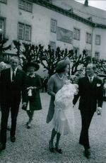 Princess Benedikte carrying her child while walking with Prince Richard VI, 1969.