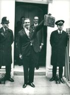 Denis Healey with this year's budget off 10 Downing Street