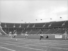 contestants running on race track, 1966.