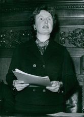 Mary Sugden looking at something and smiling.