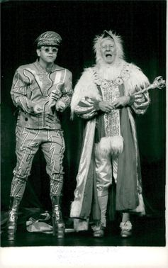 Elton John and John Gielgud perform at the Royal Theater for charity purposes.