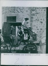 Queen Anne-Marie with Countess di Zoppola on a horse carriage, looking towards the camera.
