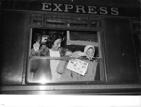 A woman with children looking through the window. 1951