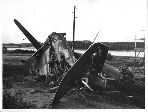 The twisted remains of a destroyed torpedo planes at an aircraft crash