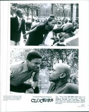 Top: Young Tyrone (Pee Wee Love) looks up to Strike, a fact that the boy's irate mother, Iris (Regina Taylor), finds intolerable.Bottom: Police officer and neighbor Andre (Keith David) warns Strike not to recruit the youths who reside in the projects.