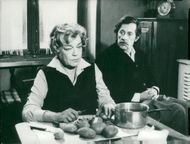"Simone Signoret scales potatoes in a scene from the movie ""I Sent a Letter to My Love"""